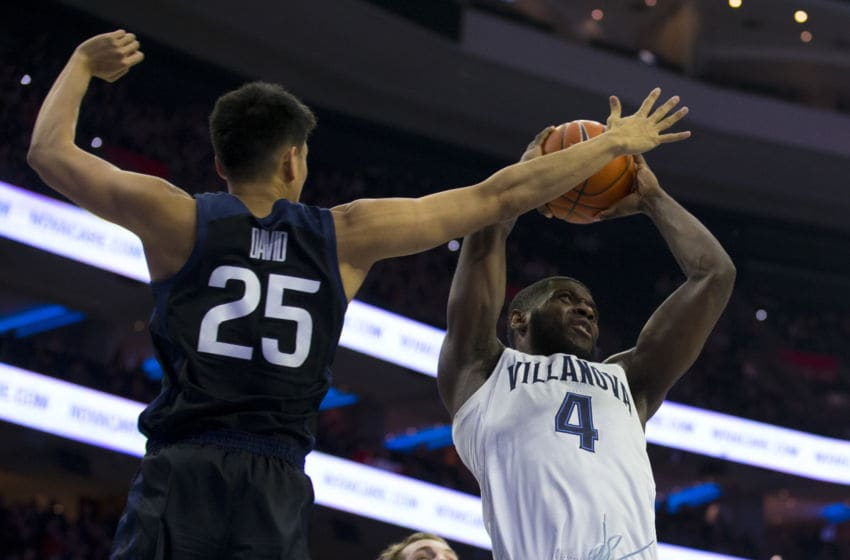 PHILADELPHIA, PA - MARCH 02: Eric Paschall #4 of the Villanova Wildcats goes up with the ball against Christian David #25 of the Butler Bulldogs in the second half at the Wells Fargo Center on March 2, 2019 in Philadelphia, Pennsylvania. Villanova defeated Butler 75-54. (Photo by Mitchell Leff/Getty Images)