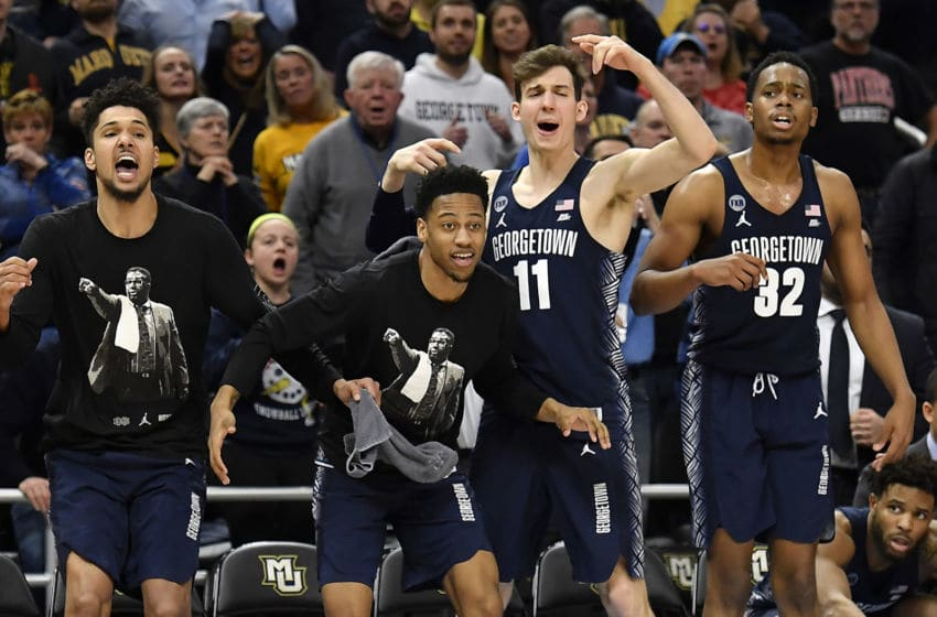 MILWAUKEE, WISCONSIN - MARCH 09: Greg Malinowski #11 of the Georgetown Hoyas and teammates react from the bench during the second half of the game against the Marquette Golden Eagles at Fiserv Forum on March 09, 2019 in Milwaukee, Wisconsin. (Photo by Quinn Harris/Getty Images)