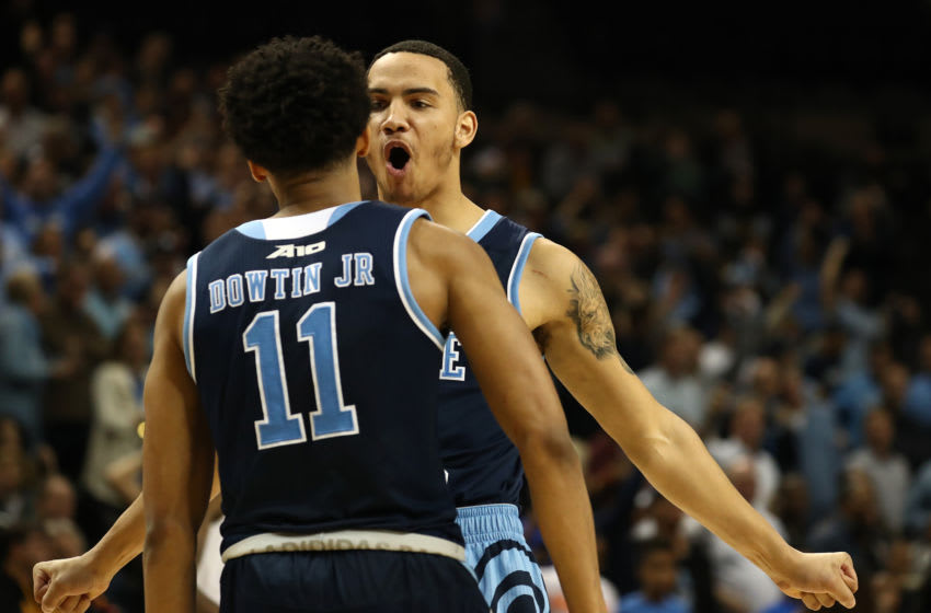 NEW YORK, NEW YORK - MARCH 15: Tyrese Martin #4 and Jeff Dowtin #11 of the Rhode Island Rams celebrate against the Virginia Commonwealth Rams during their Atlantic 10 basketball tournament quarterfinal game at Barclays Center on March 15, 2019 in New York City. (Photo by Al Bello/Getty Images)