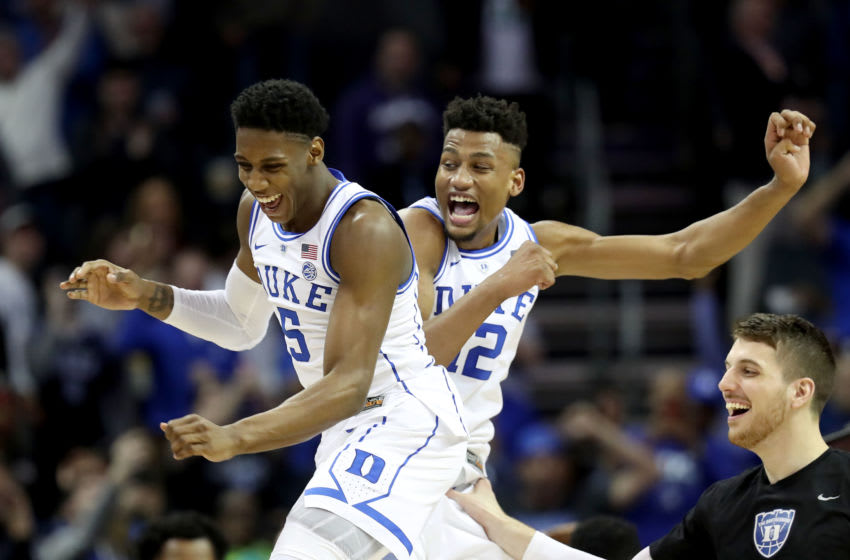 CHARLOTTE, NORTH CAROLINA - MARCH 16: Teammates RJ Barrett #5 and Javin DeLaurier #12 of the Duke Blue Devils celebrate their 73-63 victory over the Florida State Seminoles in the championship game of the 2019 Men's ACC Basketball Tournament at Spectrum Center on March 16, 2019 in Charlotte, North Carolina. (Photo by Streeter Lecka/Getty Images)