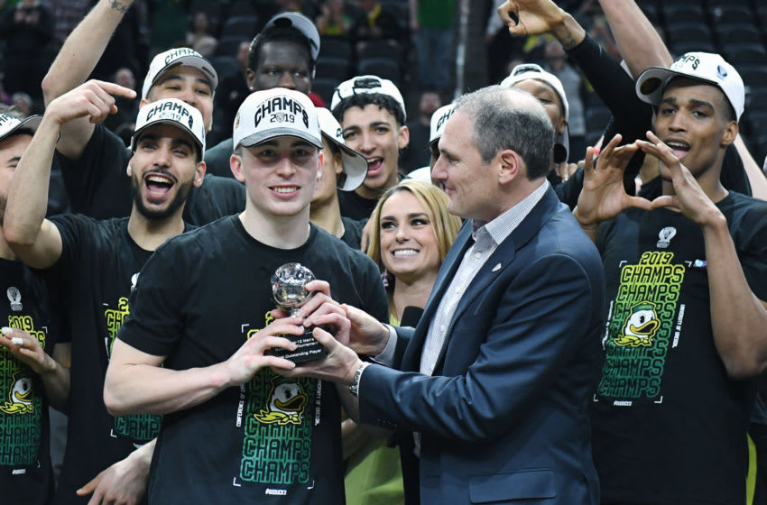 LAS VEGAS, NEVADA - MARCH 16: Pac-12 Commissioner Larry Scott presents Payton Pritchard #3 of the Oregon Ducks with the Most Outstanding Player award after the Ducks' 68-48 victory over the Washington Huskies to win the championship game of the Pac-12 basketball tournament at T-Mobile Arena on March 16, 2019 in Las Vegas, Nevada. (Photo by Ethan Miller/Getty Images)