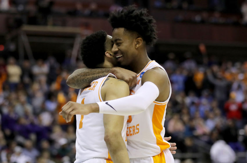 COLUMBUS, OHIO - MARCH 24: Lamonte Turner #1 and Jordan Bowden #23 of the Tennessee Volunteers react after defeating the Iowa Hawkeyes 83-77 in the Second Round of the NCAA Basketball Tournament at Nationwide Arena on March 24, 2019 in Columbus, Ohio. (Photo by Elsa/Getty Images)