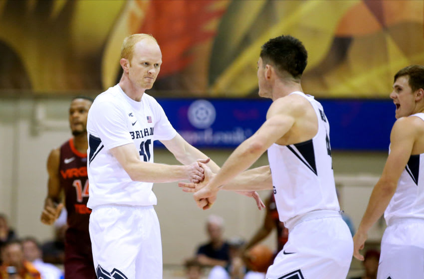 LAHAINA, HI - NOVEMBER 27: TJ Haws #30 of the BYU Cougars gets five from teammate Alex Barcello #4 after making a three point basket during the second half of the game against the Virginia Tech Hokies at the Lahaina Civic Center on November 27, 2019 in Lahaina, Hawaii. (Photo by Darryl Oumi/Getty Images)