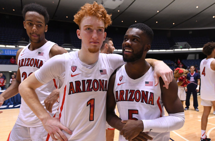 ANAHEIM, CA - DECEMBER 01: Nico Mannion #1 of the Arizona Wildcats is congratulated by Max Hazzard #5 of the Arizona Wildcats after being named tournament MVP as the Wildcats defeated the Wake Forest Demon Deacons 73-66 to win the Wooden Legacy at the Anaheim Convention Center at on December 1, 2019 in Anaheim, California. (Photo by Jayne Kamin-Oncea/Getty Images)