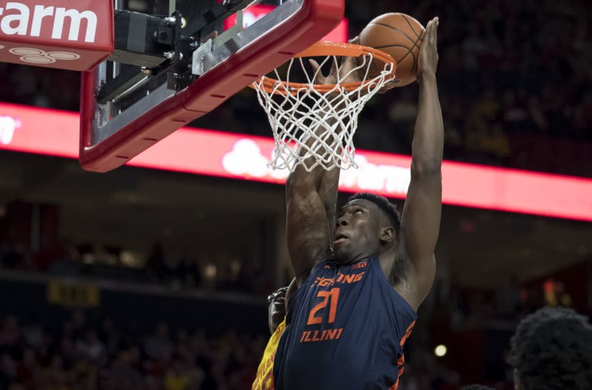 COLLEGE PARK, MD - DECEMBER 07: Kofi Cockburn #21 of the Illinois Fighting Illini dunks the ball against Jalen Smith #25 of the Maryland Terrapins during the first half at Xfinity Center on December 7, 2019 in College Park, Maryland. (Photo by Scott Taetsch/Getty Images)