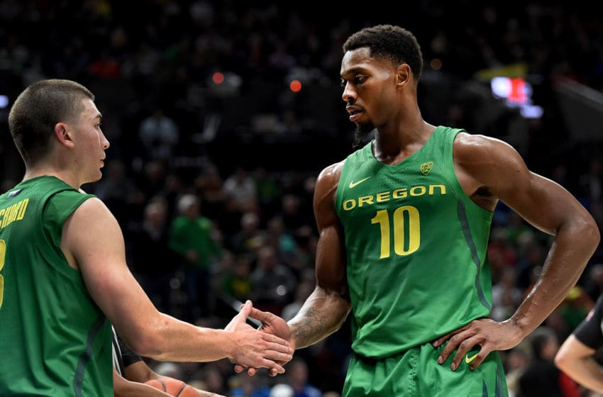 PORTLAND, OREGON - NOVEMBER 12: Payton Pritchard #3 of the Oregon Ducks and Shakur Juiston #10 of the Oregon Ducks speakduring the second half of the game against the Memphis Tigers at Moda Center on November 12, 2019 in Portland, Oregon. Oregon won the game 82-74. (Photo by Steve Dykes/Getty Images)