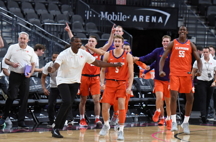 LAS VEGAS, NEVADA - NOVEMBER 24: Members of the Clemson Tigers celebrate at what appeared to be the end of their game against the TCU Horned Frogs during the MGM Resorts Main Event basketball tournament at T-Mobile Arena on November 24, 2019 in Las Vegas, Nevada. The Tigers defeated the Horned Frogs 62-60 in overtime. (Photo by Ethan Miller/Getty Images)