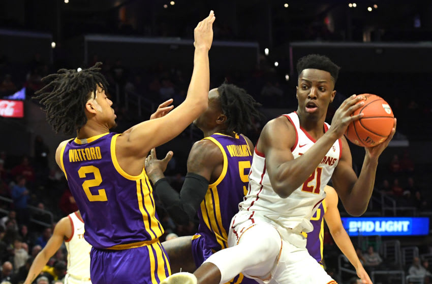 LOS ANGELES, CA - DECEMBER 21: Trendon Watford #2 and Emmitt Williams #5 of the LSU Tigers defend Onyeka Okongwu #21 of the USC Trojans as he grabs a rebound in the second half of the game at Staples Center on December 21, 2019 in Los Angeles, California. (Photo by Jayne Kamin-Oncea/Getty Images)