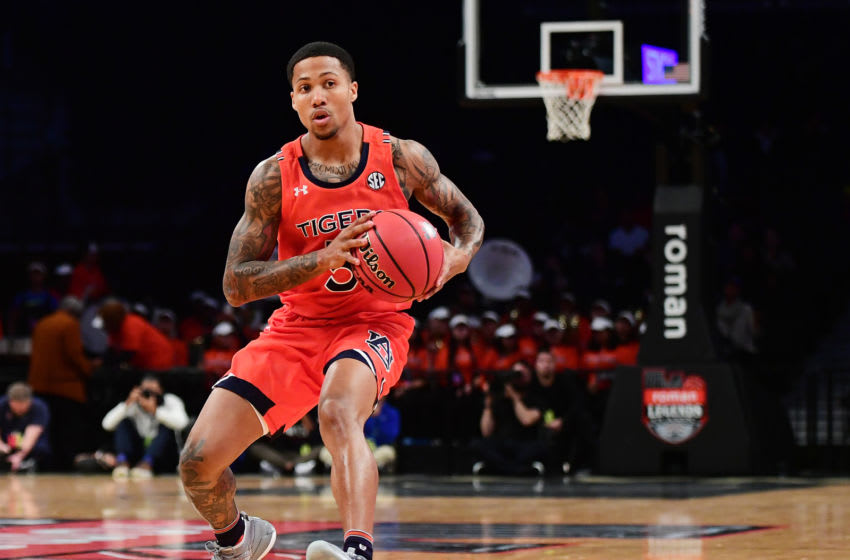 NEW YORK, NEW YORK - NOVEMBER 25: J'Von McCormick #5 of the Auburn Tigers looks to pass during the first half against the New Mexico Lobos at Barclays Center on November 25, 2019 in New York City. (Photo by Emilee Chinn/Getty Images)