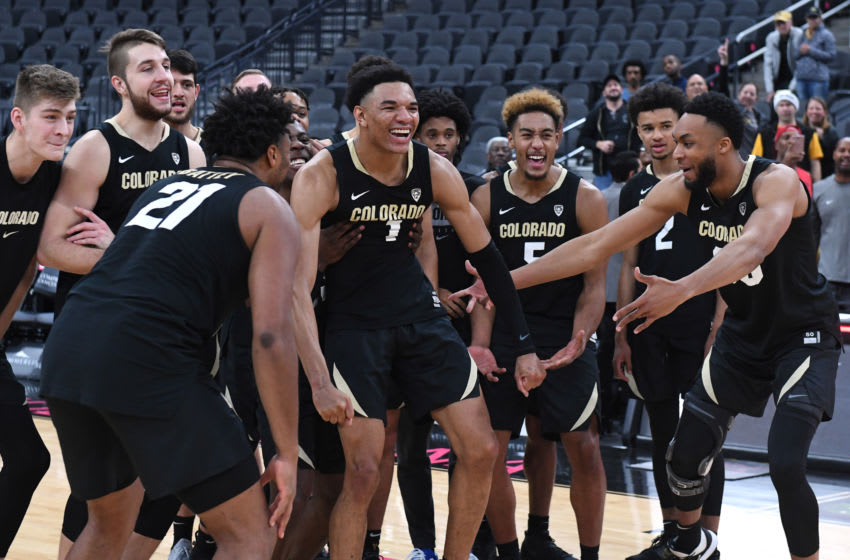 LAS VEGAS, NEVADA - NOVEMBER 26: Tyler Bey #1 of the Colorado Buffaloes is mobbed by teammates as he is announced as the tournament MVP after the team's 71-67 victory over the Clemson Tigers to win the MGM Resorts Main Event basketball tournament at T-Mobile Arena on November 26, 2019 in Las Vegas, Nevada. (Photo by Ethan Miller/Getty Images)