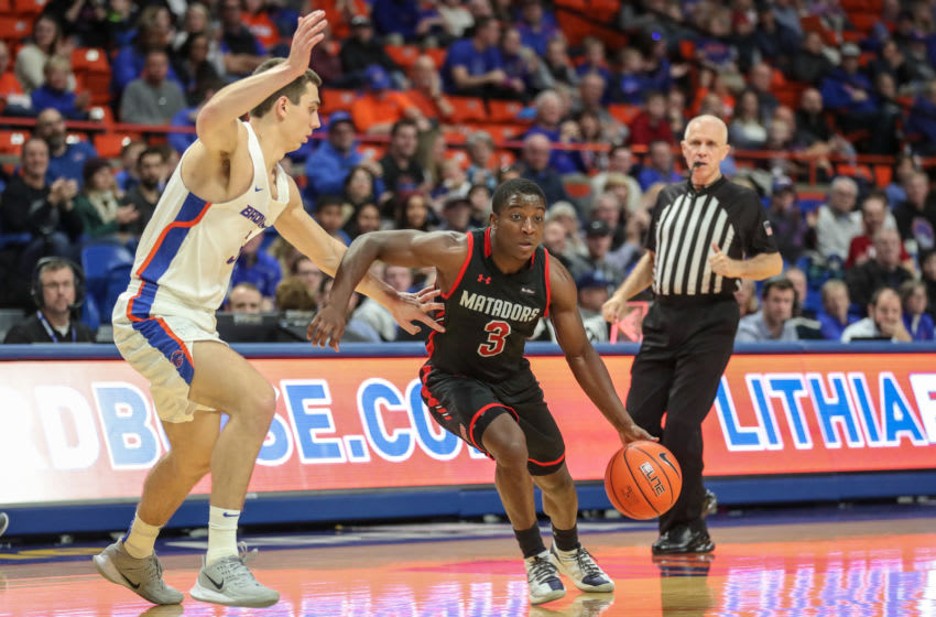 BOISE, ID - DECEMBER 28: Guard Terrell Gomez #3 of the CSU Northridge Matadors dribbles around the defense of guard Justinian Jessup #3 of the Boise State Broncos during second half action at ExtraMile Arena on December 28, 2019 in Boise, Idaho. Boise State won the game 103-72. (Photo by Loren Orr/Getty Images)