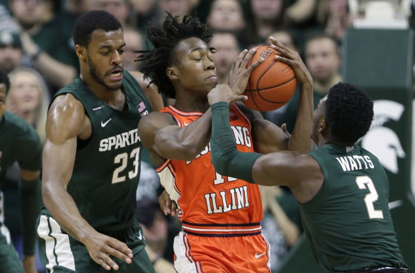 EAST LANSING, MI - JANUARY 2: Ayo Dosunmu #11 of the Illinois Fighting Illini is pressured by Xavier Tillman #23 and Rocket Watts #2 of the Michigan State Spartans during the first half at Breslin Center on January 2, 2020, in East Lansing, Michigan. (Photo by Duane Burleson/Getty Images)