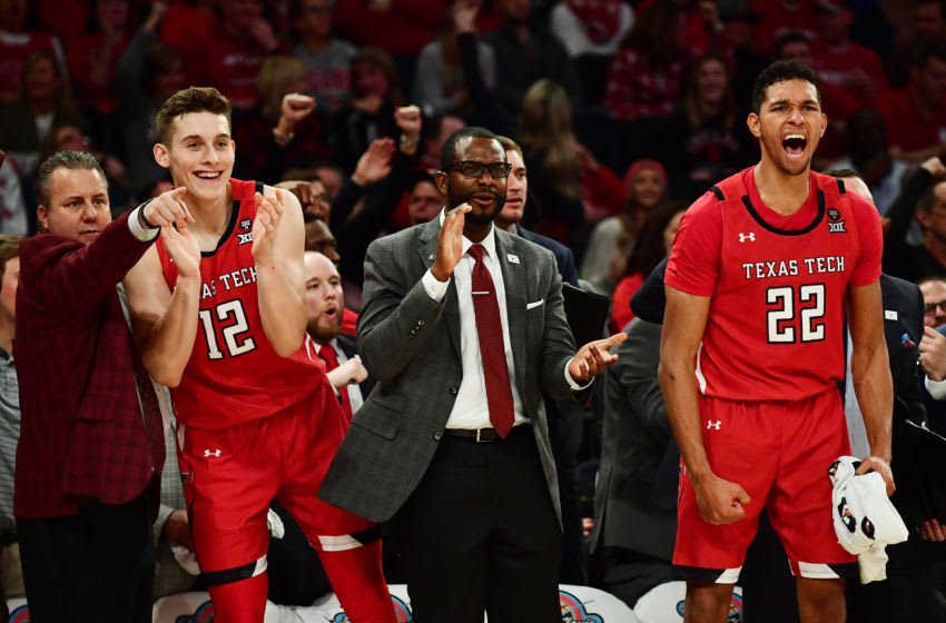 NEW YORK, NEW YORK - DECEMBER 10: Andrei Savrasov #12 and TJ Holyfield #22 of the Texas Tech Red Raiders react from the bench during the second half of their game at Madison Square Garden on December 10, 2019 in New York City. (Photo by Emilee Chinn/Getty Images)