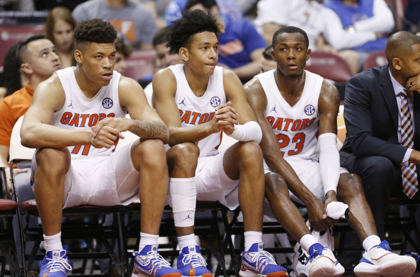 SUNRISE, FLORIDA - DECEMBER 21: Keyontae Johnson #11, Tre Mann #1, and Scottie Lewis #23 of the Florida Gators look on against the Utah State Aggies during the second half of the Orange Bowl Basketball Classic at BB&T Center on December 21, 2019 in Sunrise, Florida. (Photo by Michael Reaves/Getty Images)