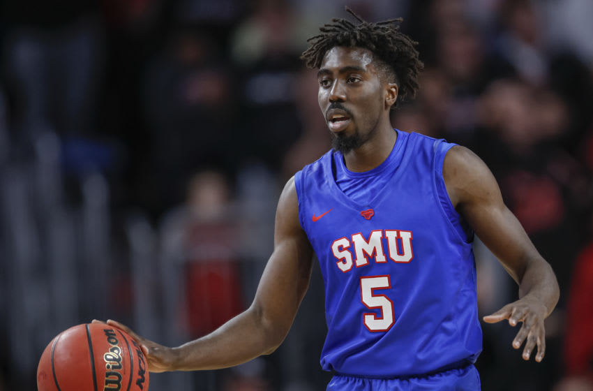 CINCINNATI, OH - JANUARY 28: Emmanuel Bandoumel #5 of the Southern Methodist Mustangs brings the ball up court during the game against the Cincinnati Bearcats at Fifth Third Arena on January 28, 2020 in Cincinnati, Ohio. (Photo by Michael Hickey/Getty Images)