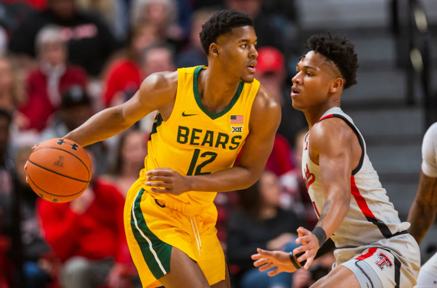 LUBBOCK, TEXAS - JANUARY 07: Guard Jared Butler #12 of the Baylor Bears handles the ball against guard Terrence Shannon #1 of the Texas Tech Red Raiders during the first half of the college basketball game on January 07, 2020 at United Supermarkets Arena in Lubbock, Texas. (Photo by John E. Moore III/Getty Images)