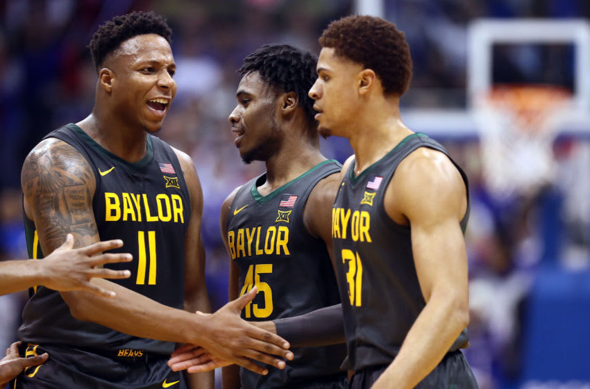 LAWRENCE, KANSAS - JANUARY 11: Mark Vital #11 and Davion Mitchell #45 of the Baylor Bears congratulate MaCio Teague #31 after a basket during the game against the Kansas Jayhawks at Allen Fieldhouse on January 11, 2020 in Lawrence, Kansas. (Photo by Jamie Squire/Getty Images)