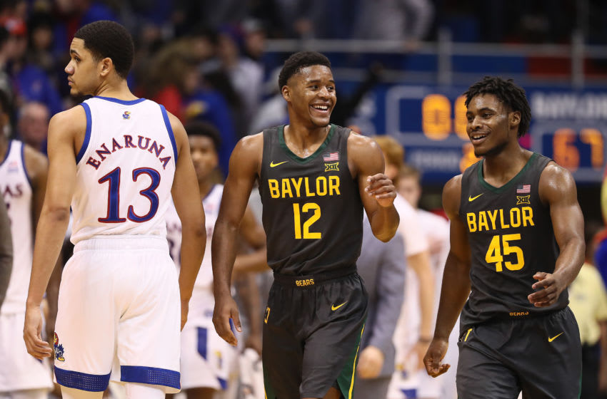 LAWRENCE, KANSAS - JANUARY 11: Jared Butler #12 and Davion Mitchell #45 of the Baylor Bears smile as Baylor defeats the Kansas Jayhawks to win the game at Allen Fieldhouse on January 11, 2020 in Lawrence, Kansas. (Photo by Jamie Squire/Getty Images)