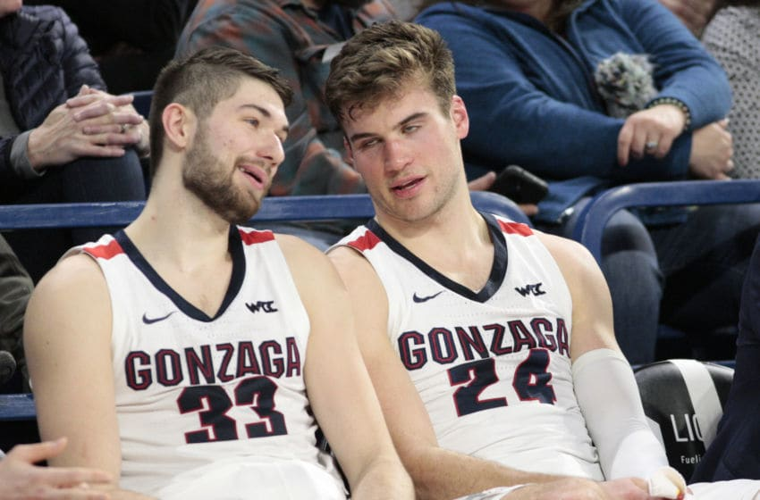 SPOKANE, WASHINGTON - JANUARY 16: Killian Tillie #33 and Corey Kispert #24 of the Gonzaga Bulldogs look on from the bench in the second half against the Santa Clara Broncos at McCarthey Athletic Center on January 16, 2020 in Spokane, Washington. Gonzaga defeats Santa Clara 104-54. (Photo by William Mancebo/Getty Images)