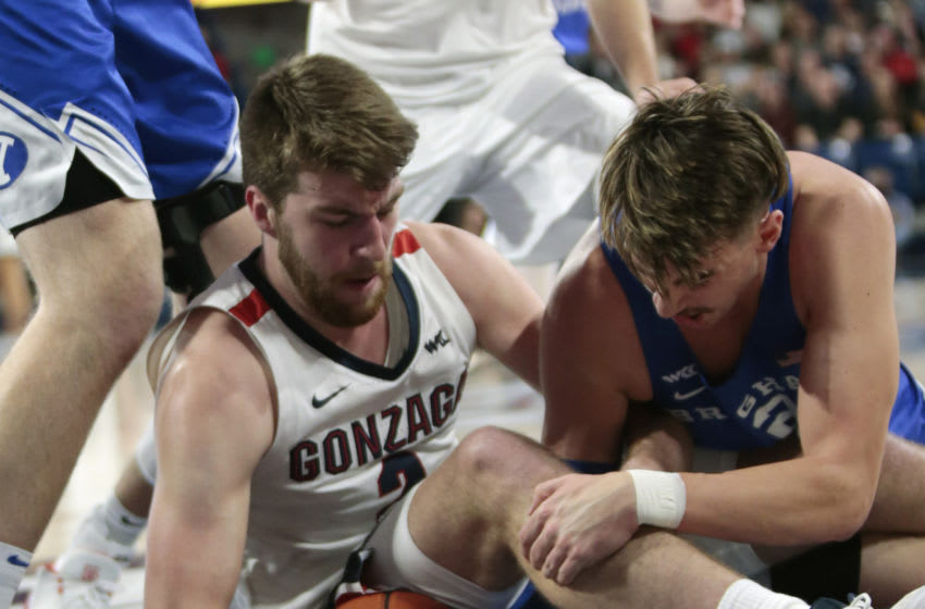 SPOKANE, WASHINGTON - JANUARY 18: Drew Timme #2 of the Gonzaga Bulldogs battles for control of a loose ball against Zac Seljass #2 of the BYU Cougars in the first half at McCarthey Athletic Center on January 18, 2020 in Spokane, Washington. (Photo by William Mancebo/Getty Images)