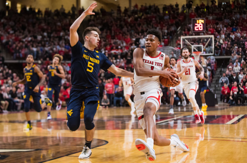 LUBBOCK, TEXAS - JANUARY 29: Guard Terrence Shannon Jr. #1 of the Texas Tech Red Raiders drives against guard Jordan McCabe #5 of the West Virginina Mountaineers during the first half of the college basketball game at United Supermarkets Arena on January 29, 2020 in Lubbock, Texas. (Photo by John E. Moore III/Getty Images)