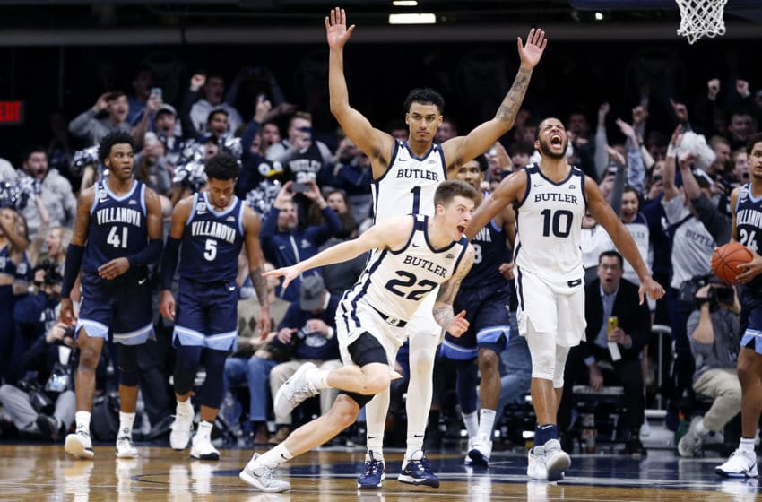 INDIANAPOLIS, INDIANA - FEBRUARY 05: Sean McDermott #22, Jordan Tucker #1 and Bryce Nze #10 of the Butler Bulldogs celebrate after their win over the Villanova Wildcats at Hinkle Fieldhouse on February 05, 2020 in Indianapolis, Indiana. The Bulldogs defeated the Wildcats 79-76. (Photo by Justin Casterline/Getty Images)