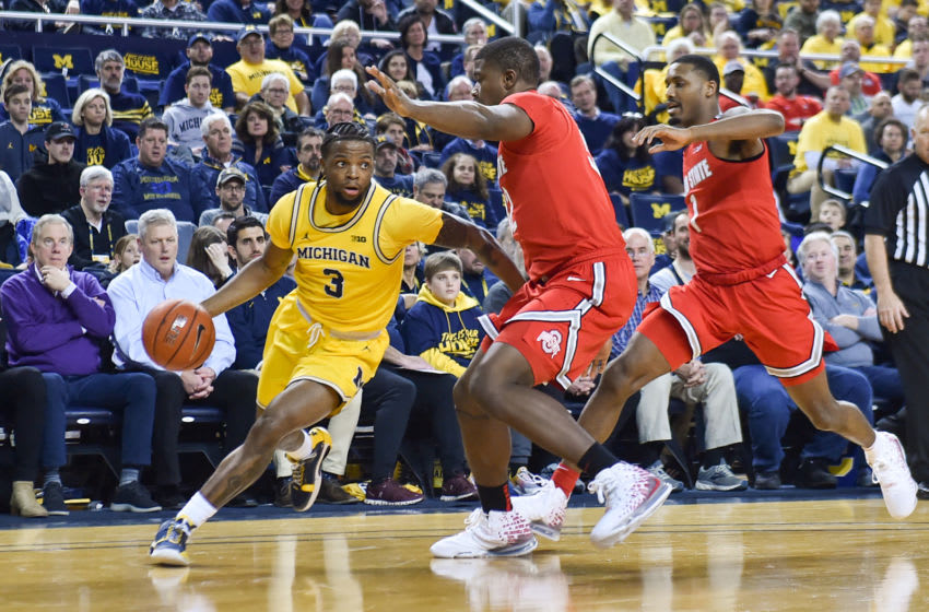 ANN ARBOR, MICHIGAN - FEBRUARY 04: Zavier Simpson #3 of the Michigan Wolverines dribbles around Ohio State Buckeyes players during the first half of a college basketball game at Crisler Arena on February 04, 2020 in Ann Arbor, Michigan. (Photo by Aaron J. Thornton/Getty Images)