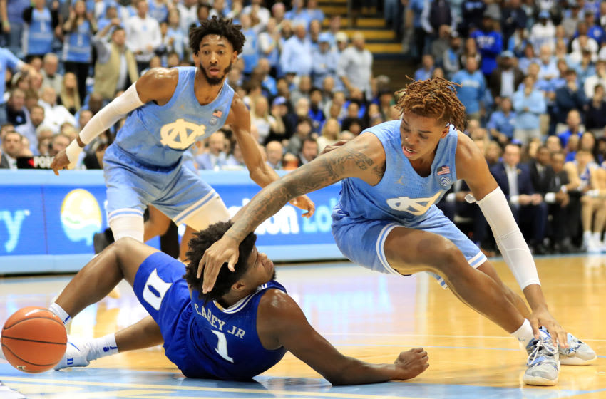 CHAPEL HILL, NORTH CAROLINA - FEBRUARY 08: Vernon Carey Jr. #1 of the Duke Blue Devils goes after a loose ball against Armando Bacot #5 of the North Carolina Tar Heels during their game at Dean Smith Center on February 08, 2020 in Chapel Hill, North Carolina. (Photo by Streeter Lecka/Getty Images)