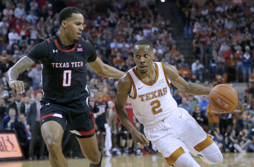 AUSTIN, TEXAS - FEBRUARY 08: Matt Coleman III #2 of the Texas Longhorns drives around Kyler Edwards #0 of the Texas Tech Red Raiders at The Frank Erwin Center on February 08, 2020 in Austin, Texas. (Photo by Chris Covatta/Getty Images)
