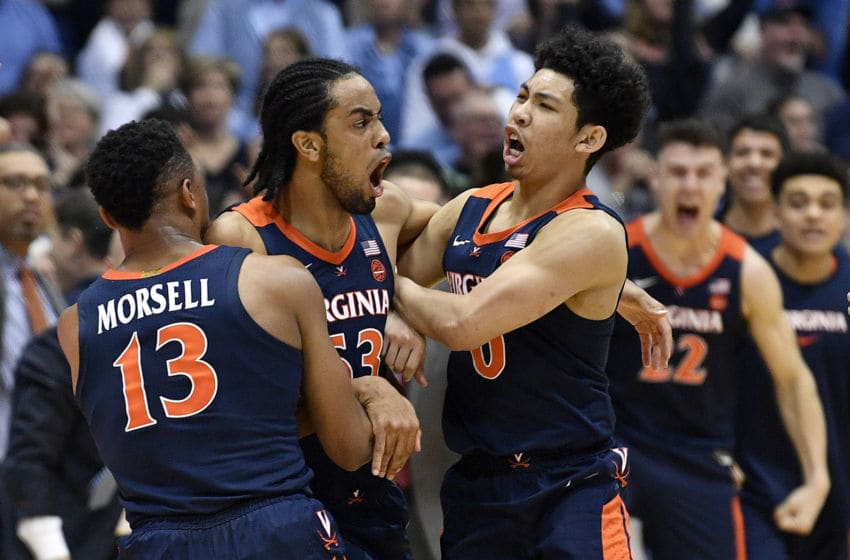 CHAPEL HILL, NORTH CAROLINA - FEBRUARY 15: Tomas Woldetensae #53 of the Virginia Cavaliers celebrates with teammates after scoring the game-winning basket during the second half of their game against the North Carolina Tar Heels at the Dean Smith Center on February 15, 2020 in Chapel Hill, North Carolina. Virginia won 64-62. (Photo by Grant Halverson/Getty Images)