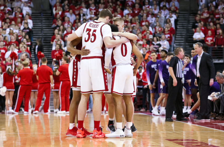 MADISON, WISCONSIN - MARCH 04: The Wisconsin Badgers huddle before the game against the Northwestern Wildcats at the Kohl Center on March 04, 2020 in Madison, Wisconsin. (Photo by Dylan Buell/Getty Images)