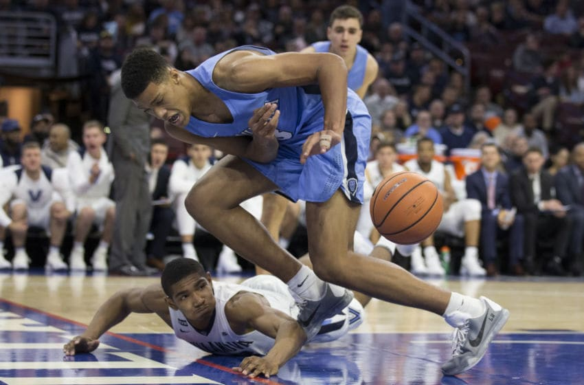 PHILADELPHIA, PA - NOVEMBER 10: Patrick Tape #3 of the Columbia Lions looses possession of the ball against Jermaine Samuels #23 of the Villanova Wildcats in the second half at the Wells Fargo Center on November 10, 2017 in Philadelphia, Pennsylvania. The Villanova Wildcats defeated the Columbia Lions 75-60. (Photo by Mitchell Leff/Getty Images)
