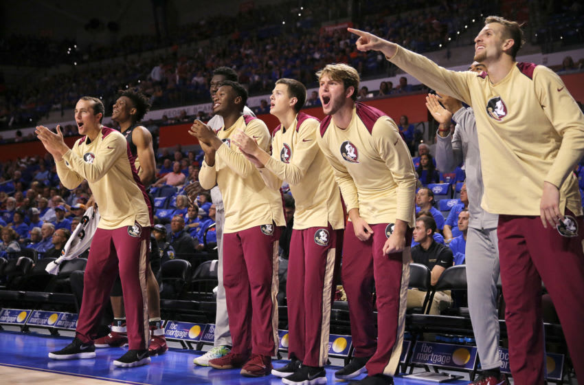 GAINESVILLE, FL - DECEMBER 04: The Florida State bench cheers after a score during a NCAA basketball game against the Florida Gators at the Stephen C. O' Connell Center on December 4, 2017 in Gainesville, Florida. (Photo by Alex Menendez/Getty Images)