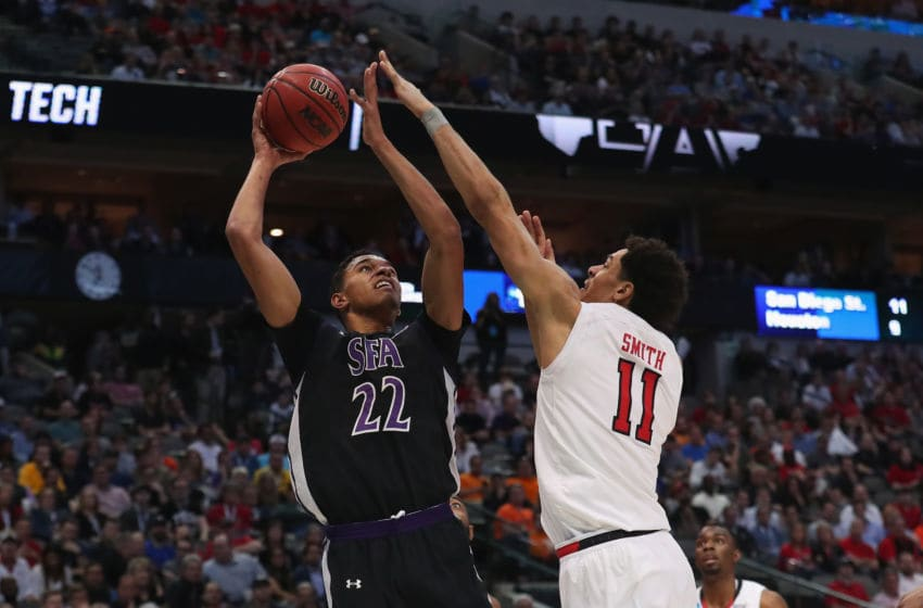 DALLAS, TX - MARCH 15: TJ Holyfield #22 of the Stephen F. Austin Lumberjacks shoots against Zach Smith #11 of the Texas Tech Red Raiders in the first half in the first round of the 2018 NCAA Men's Basketball Tournament at American Airlines Center on March 15, 2018 in Dallas, Texas. (Photo by Tom Pennington/Getty Images)