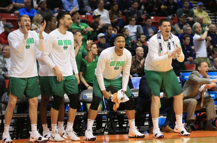 SAN DIEGO, CA - MARCH 18: The Marshall Thundering Herd bench cheers as they take on the West Virginia Mountaineers in the first half during the second round of the 2018 NCAA Men's Basketball Tournament at Viejas Arena on March 18, 2018 in San Diego, California. (Photo by Sean M. Haffey/Getty Images)