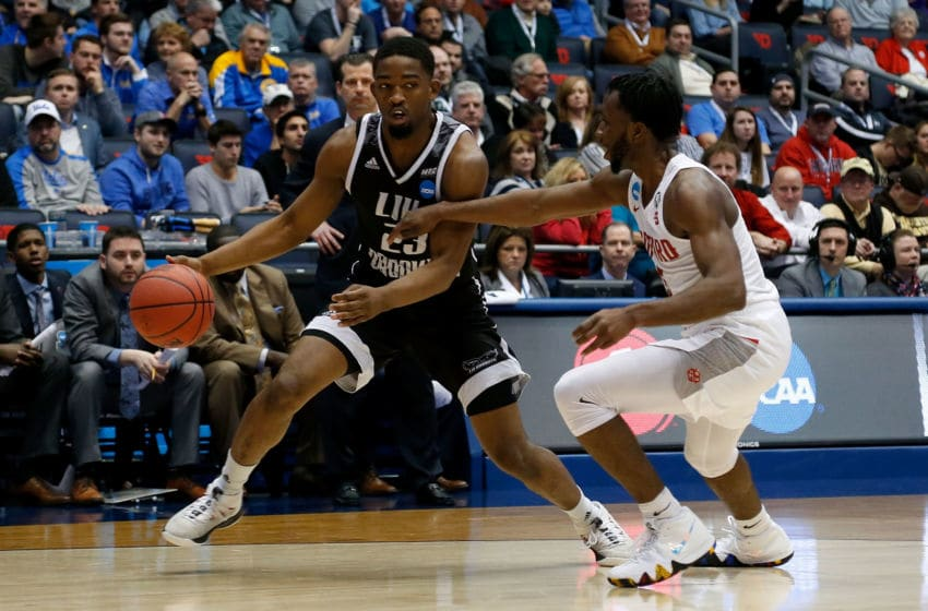 DAYTON, OH - MARCH 13: Donald Hicks #5 of the Radford Highlanders defends against Raiquan Clark #23 of the LIU Brooklyn Blackbirds during the game at UD Arena on March 13, 2018 in Dayton, Ohio. (Photo by Kirk Irwin/Getty Images)