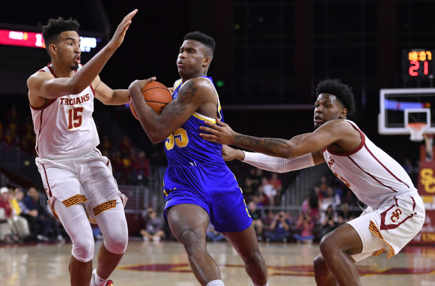 LOS ANGELES, CA - NOVEMBER 12: Isaiah Mobley #15 of the USC Trojans guards Douglas Wilson #35 of the South Dakota State Jackrabbits while Elijah Weaver #3 holds on in the first half at Galen Center on November 12, 2019 in Los Angeles, California. (Photo by John McCoy/Getty Images)