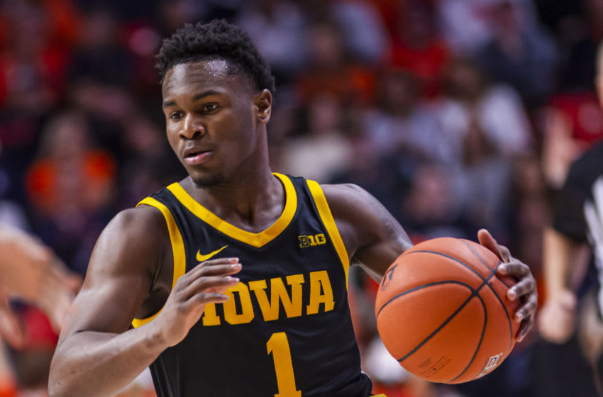 CHAMPAIGN, IL - MARCH 08: Joe Toussaint #1 of the Iowa Hawkeyes brings the ball up court during the game against the Illinois Fighting Illini at State Farm Center on March 8, 2020 in Champaign, Illinois. (Photo by Michael Hickey/Getty Images)