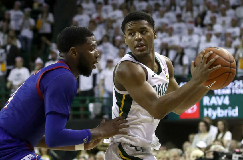 WACO, TEXAS - FEBRUARY 22: Jared Butler #12 of the Baylor Bears and Isaiah Moss #4 of the Kansas Jayhawks at Ferrell Center on February 22, 2020 in Waco, Texas. (Photo by Ronald Martinez/Getty Images)
