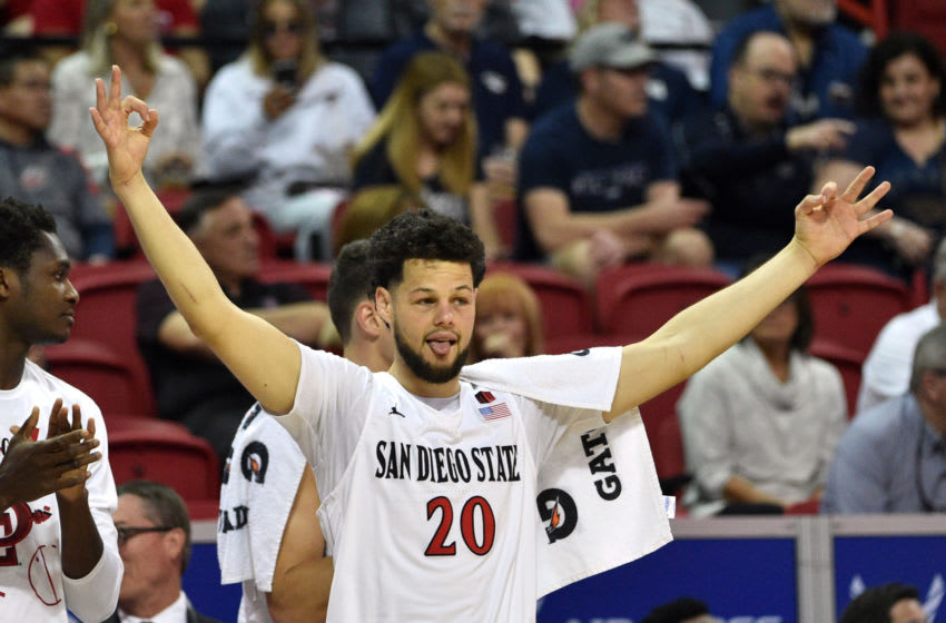 LAS VEGAS, NEVADA - MARCH 05: Jordan Schakel #20 of the San Diego State Aztecs reacts after a three point basket during a quarterfinal game of the Mountain West Conference basketball tournament against the Air Force Falcons at the Thomas & Mack Center on March 5, 2020 in Las Vegas, Nevada. (Photo by David Becker/Getty Images)