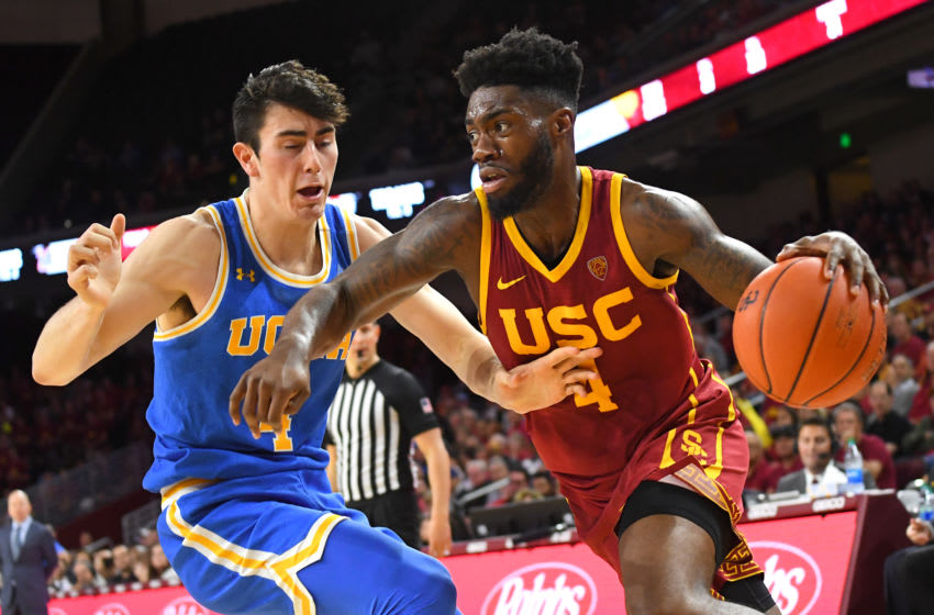 LOS ANGELES, CA - MARCH 07: Jaime Jaquez Jr. #4 of the UCLA Bruins guards Daniel Utomi #4 of the USC Trojans as he drives to the basket in the game at Galen Center on March 7, 2020 in Los Angeles, California. (Photo by Jayne Kamin-Oncea/Getty Images)