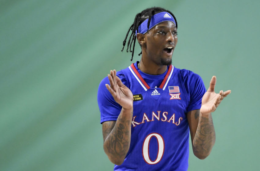 FORT MYERS, FLORIDA - NOVEMBER 26: Marcus Garrett #0 of the Kansas Jayhawks reacts during the first half against the Gonzaga Bulldogs during the Rocket Mortgage Fort Myers Tip-Off at Suncoast Credit Union Arena on November 26, 2020 in Fort Myers, Florida. (Photo by Douglas P. DeFelice/Getty Images)