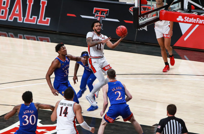 LUBBOCK, TEXAS - DECEMBER 17: Guard Kyler Edwards #11 of the Texas Tech Red Raiders shoots the ball during the second half of the college basketball game against the Kansas Jayhawks at United Supermarkets Arena on December 17, 2020 in Lubbock, Texas. (Photo by John E. Moore III/Getty Images)