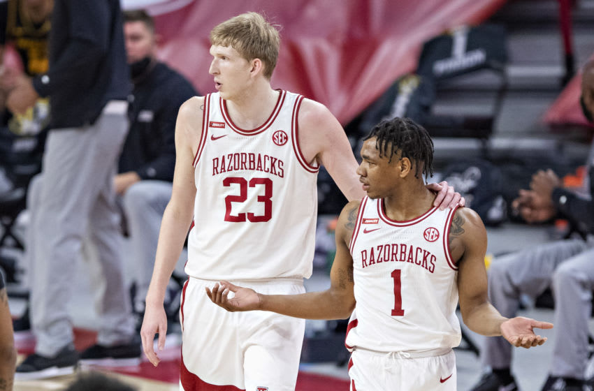 FAYETTEVILLE, ARKANSAS - JANUARY 02: Connor Vanover #23 comforts JD Notae #1 of the Arkansas Razorbacks during a game against the Missouri Tigers at Bud Walton Arena on January 02, 2021 in Fayetteville, Arkansas. The Tigers defeated the Razorbacks 81-68. (Photo by Wesley Hitt/Getty Images)