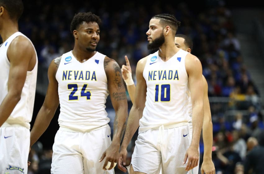 ATLANTA, GA - MARCH 22: Jordan Caroline #24 and Caleb Martin #10 of the Nevada Wolf Pack react after a play in the second half against the Loyola Ramblers during the 2018 NCAA Men's Basketball Tournament South Regional at Philips Arena on March 22, 2018 in Atlanta, Georgia. (Photo by Ronald Martinez/Getty Images)