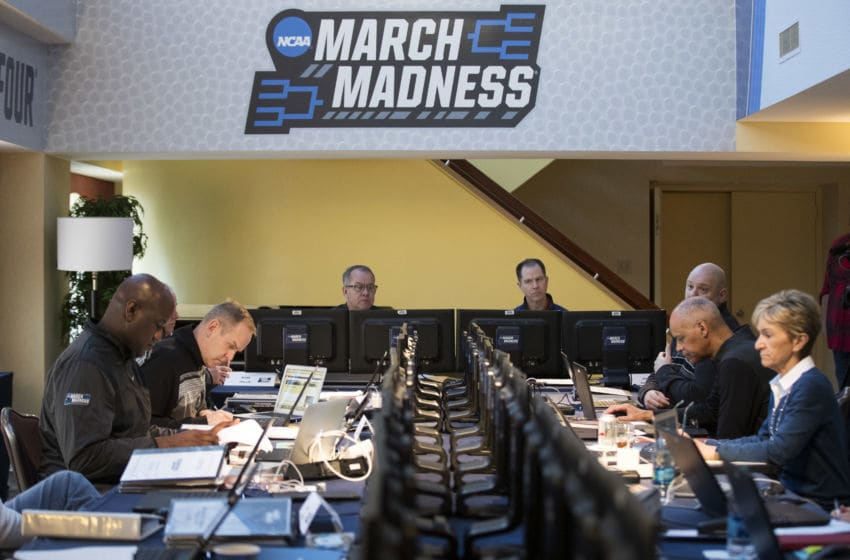 NEW YORK, NY - MARCH 8: Led by committee chairman Mark Hollis (3rd from L), the NCAA Basketball Tournament Selection Committee meets on Wednesday afternoon, March 8, 2017 in New York City. The committee is gathered in New York to begin the five-day process of selecting and seeding the field of 68 teams for the NCAA MenÕs Basketball Tournament. The final bracket will be released on Sunday evening following the completion of conference tournaments. (Photo by Drew Angerer/Getty Images)