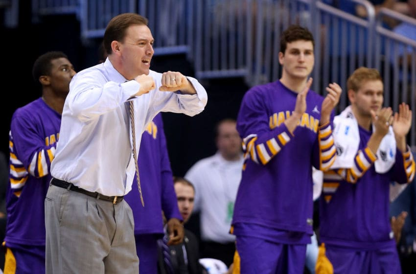 ORLANDO, FL - MARCH 20: Head coach Will Brown of the Albany Great Danes calls out in the first half while taking on the Florida Gators during the second round of the 2014 NCAA Men's Basketball Tournament at Amway Center on March 20, 2014 in Orlando, Florida. (Photo by Mike Ehrmann/Getty Images)