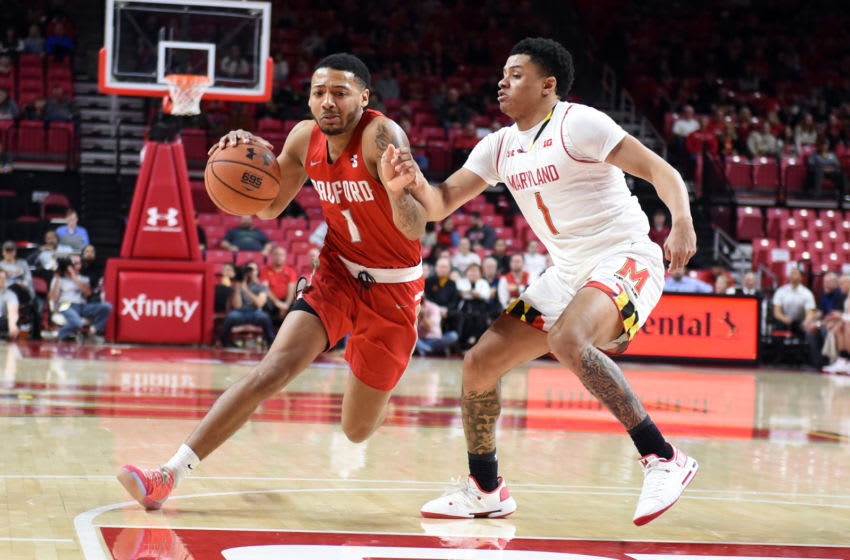 COLLEGE PARK, MD - DECEMBER 29: Carlik Jones #1 of the Radford Highlanders dribbles by Anthony Cowan Jr. #1 of the Maryland Terrapins during a college basketball game at XFinity Center on December 29, 2018 in College Park, Maryland. (Photo by Mitchell Layton/Getty Images)