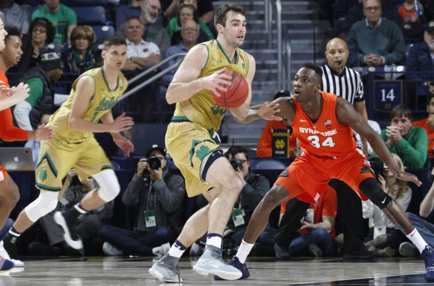 SOUTH BEND, IN - JANUARY 05: John Mooney #33 of the Notre Dame Fighting Irish looks to the basket while defended by Bourama Sidibe #34 of the Syracuse Orange in the second half of the game at Purcell Pavilion on January 5, 2019 in South Bend, Indiana. Syracuse won 72-62. (Photo by Joe Robbins/Getty Images)
