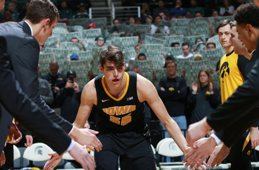 EAST LANSING, MI - DECEMBER 03: Luka Garza #55 of the Iowa Hawkeyes during pregame introductions before the game against the Michigan State Spartans at Breslin Center on December 3, 2018 in East Lansing, Michigan. (Photo by Rey Del Rio/Getty Images)